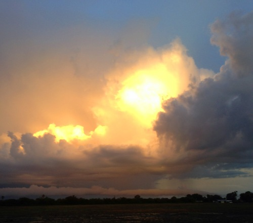 SUNSET LIGHT reflected off of Storm Clouds in Ruskin Florida